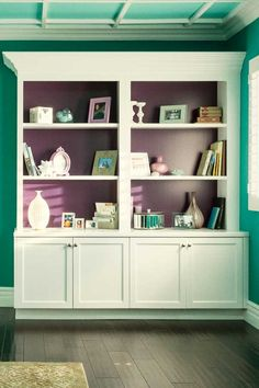 Would you paint the back of your bookshelves in a fun shade? This space uses Glidden's Delicious Plum!