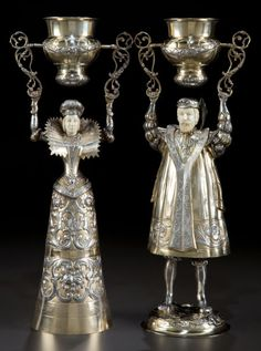 ❤ - A PAIR OF WILHELM WEINRANCK LARGE HANAU SILVER, SILVER GILT AND  IVORY FIGURAL WAGER CUPS .