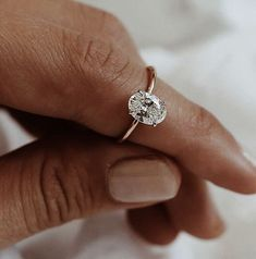 Oval Solitaire Bespoke Engagement Ring. A 1.5 carat diamond set in white gold on a fine rose gold band.