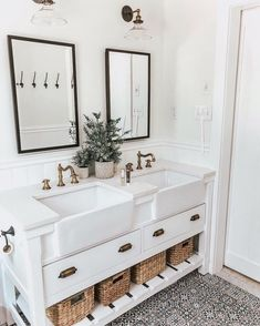 Great farmhouse style bathroom. The color scheme is a little too bland. Some art or more plants would be nice with some colored hand towels.