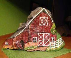 Farm/barn scene painted on 40 pound stone, all sides painted. $100. To local buyer only.