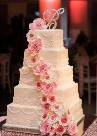 Loving this decadent white cake with pink flowers cascading down the front by Icing on the Top! Photo by Chris Humphrey Photographer. #wedding #cake #pink