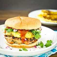 Hawaiian Turkey Burger by Foodie Bride (20 oz package of lean ground turkey, 3 Tbsp Heinz steak sauce, plus more for serving, 1/2 cup finely chopped red onion, handful chopped cilantro, salt, pepper, Worcestershire, 4 burger buns and 4 pineapple rings)