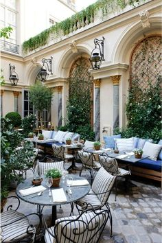 A beautiful and Italian-looking romantic outdoor setting. We love the gorgeous building and those stunning blue cushions. This image just conjures up the imagination of a glass of wine on a warm summer's evening doesn't it?