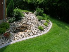 Limestone used as edging. Natural but increased cost for ...