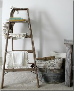 Wooden ladder filled with vintage linens brown or white? Antique Ladder, Old Ladder, Vintage Ladder, Rustic Ladder, Ladder Decor, Apartment Bedroom Decor, Two Bedroom Apartments, Old Wooden Ladders, Refinish Wood Floors