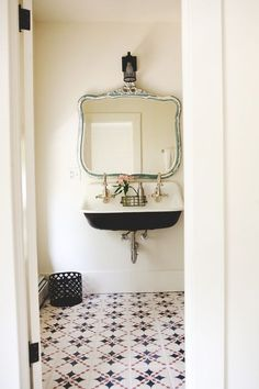 bathroom with vintage touches and graphic tile