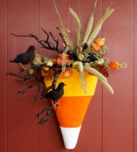 Skip the traditional door wreath and try this sweet take on an outdoor Halloween decoration. Make this easy candy corn-inspired Halloween door decoration out of foam, faux greenery and holiday accessories. Halloween Flower Arrangements, Halloween Flowers, Floral Arrangements, Fall Crafts, Holiday Crafts, Holiday Fun, Party Crafts, Diy Crafts, Homemade Halloween
