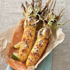 Grilled Cheesy Corn | Chili powder, smoked paprika, and lime wedges give grilled corn a Southwestern touch. Brush with melted butter and cheese to complete this dish. | SouthernLiving.com