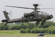 ZJ199 - 2002 build Westland Apache AH.1, hovering over the active at Barton