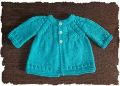 Thousands of knitters have enjoyed making my now famous 'All-in-One Baby Top'. I see them everywhere on the net. Each one is a little different ~ depending on the yarn used, additional fancy sti