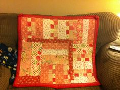 Baby quilted blanket in shades of red & pink