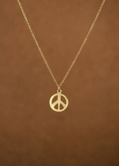 Gold peace sign necklace - peace necklace - delicate and dainty -  a 22k gold plated little gold peace symbol on a 14k gold filled chain on Etsy, $22.00