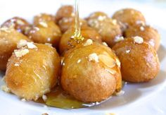 Loukoumades recipe (Greek Donuts with Honey and Walnuts) - A traditional Greek delicacy | Greek food experiences in Athens! http://www.athenswalkingtours.gr/culinary-tours-athens #greekrecipe #greekcooking #greekdessert