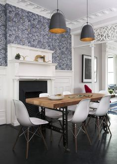 Modern dining room with industrial influences + Haleigh wire dome pendants from Rejuvenation.