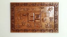 "This is a custom ""Life Collage"" I created for our dad's 85th.  We filled this wall hanging with wood carvings that were the most important to him throughout his life.   This an ""original"" design by TheWoodGrainGallery.  Picture collages are very popular but we wanted to give our dad something 3-dimensional.  I'll never forget the look in his eyes when he opened the gift!  We can create one for your family too; birthdays, graduations, weddings, sport careers; the options are endless."