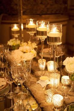 The candle lighting drastically change the look of this winter table setting. #WeddingCenterpieces