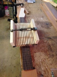 shaping fret board radius with handmade radius block