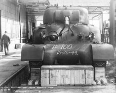The 1000th M4 Sherman tank rebuilt at the Chrysler Evansville Ordnance plant in late 1944.  Note the wide fenders on this M4A1.