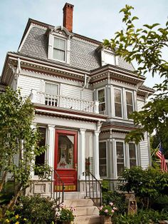 Porch, pop-out, and roomy Mansard style roof.