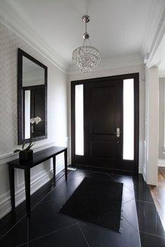 Nowoczesny wiatrołap - czarna podłoga i meble, brązowe drzwi, białe ściany
