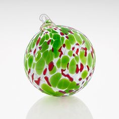 Mistletoe Magic by Kevin Boyce: Art Glass Ornament available at www.artfulhome.com Kissed with green leaves and red berries, this opaque blown glass ornament celebrates a romantic holiday tradition.