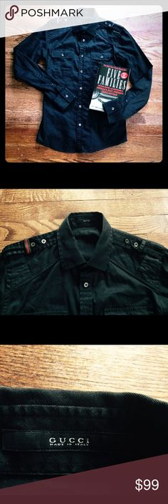 Gucci black button down shirt Authentic Gucci. Black collared button down shirt. EUC. Made in Italy. All buttons are intact and have Gucci inscribed on them. Also note traditional Gucci stripe on shoulder. Handsome piece. Size 42/16.5 Gucci Shirts Casual Button Down Shirts