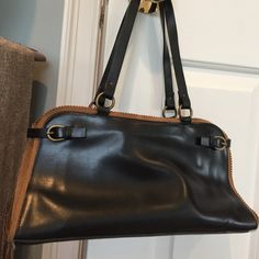 Black leather and brown suede handbag Great quality leather and suede handbag. With buckle accents and one large opening with smaller inside pockets. Slight blemishes on outside leather from normal wear Francesco Biasia Bags Satchels