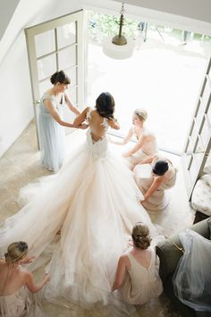 Elegant bride getting dressed with bridesmaids photo idea | Jana Williams