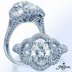 Surprise her with this stunning three-stone signature engagement ring featuring an oval diamond center