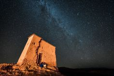 Milky Way Over Ait-Ben-Haddou - Happy Astronomy Day! Since I am editing photos from my trip to Morocco while leading a workshop for The Giving Lens, why not post an astro shot from Aït Benhaddou. This is Said and Ali from Open Doors Morocco having a moment under the rising Milky Way.