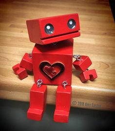 "The adorable little wooden robot ""Oddbot"", completely handmade from pinewood and hand painted. All of his limbs and head are movable so you can create a range of emotions for little Oddbot. He measures 5"" tall and is designed to sit on the edge of a shelf I can also add a short"
