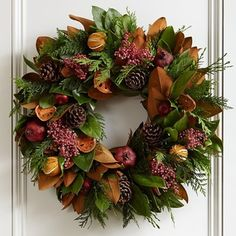 Holiday Fruit Wreath - Holiday fruits give this a pop of color. It's a substantial wreath for a large door.