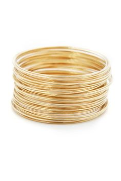 This set of thin gold bangles is versatile and chic. A great way to dress up jeans and a t-shirt or wear with a glitzy top.
