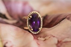 A beautiful amethyst gem captured in yellow gold that absolutely projects royalty Gemstone Colors, Gemstone Rings, Amethyst Gem, Sapphire, Royalty, Jewelry Design, Jewels, Yellow, Projects