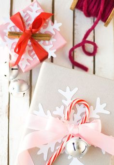 Instead of sticking with the standard bow, jazz up your gift with a cutout snowflake made of white computer paper — since every flake is unique it's literally impossible to mess up. Click through for more on this and other Christmas gift-wrapping tricks.