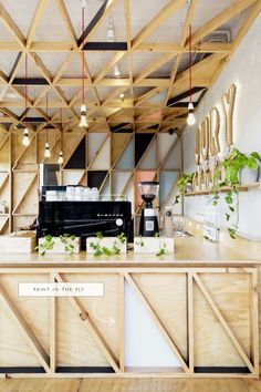 create triangle shapes with plywood and 2x4, then paint! | coco+kelley #inthedetails