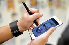 Samsung Galaxy Note  A man draws a picture using the new Samsung Galaxy Note at the Mobile World Congress Feb. 27. The smartphone, which comes with a smart pen, runs Android 2.3, has a 5.3-inch display and an 8-megapixel camera.