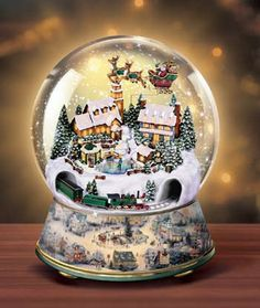 Buy Thomas Kinkade Village Christmas Animated Musical Snow Globe in our Kitchen & Home store. Snow Globes Uk, Snow Globes For Sale, Snow Globe Kit, Vintage Snow Globes, Musical Snow Globes, Christmas Snow Globes, Christmas Mood, Thomas Kinkade, Globe Animation