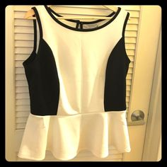 Work trendy peplum top with back button closure. Cute white and black peplum top. Never worn. No tags Bisou Bisou Tops Blouses