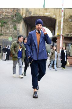 Shop this look on Lookastic:  http://lookastic.com/men/looks/beanie-longsleeve-shirt-derby-shoes-chinos-double-breasted-blazer-crew-neck-sweater-tie/6657  — Navy Beanie  — White Long Sleeve Shirt  — Black Leather Derby Shoes  — Navy Chinos  — Blue Double Breasted Blazer  — Tobacco Crew-neck Sweater  — Navy Tie