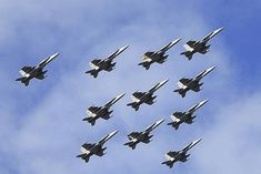 Mid Caption: On the 28 June 2012, Number 2 Operational Conversion Unit (2OCU) from RAAF Base Williamtown conducted an 11 ship formation in the F/A-18 Classic Hornet celebrating the return of five newly graduated fighter pilots from another successful High Sierra at RAAF Base Townsville.