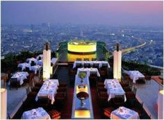 Sky Bar, Bangkok - floor of The Dome at Lebua, Sirocco State Tower. The world's highest open air bar, overlooking a panoramic view of Bangkok and the Chao Phraya River Bangkok Tour, Sky Bar Bangkok, Rooftop Restaurant, Rooftop Bar, Bangkok Restaurant, Rooftop Dining, Rooftop Lounge, Luxury Restaurant, Rooftop Bangkok