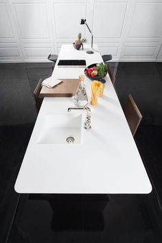 Kitch' T worktop made out of one Corian DuPont board 365x92cm #kitchen #furniture #design #compactkitchen #kitchenisle #worktop #corian #dsignedby #waterworks #faucet #hafele #contemporarykitchen #countertops #coriandesign #loftkitchen #archiproducts