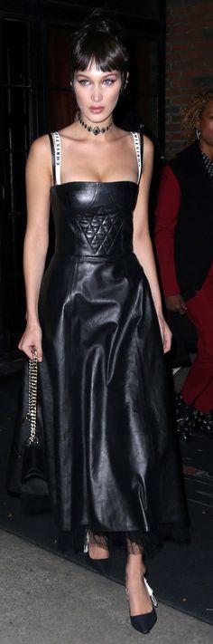 Who made  Bella Hadid's black handbag and leather dress?