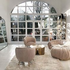 The magic here lies in the architecture and this beautiful window installation that offers a wonderful reflective quality and also draws our eyes outdoors. An adjacent sitting room is the perfect spot to daydream while starring outside, and a beautiful mod sofa system adds to the eclectic yet modern-chic ambience of this abode.