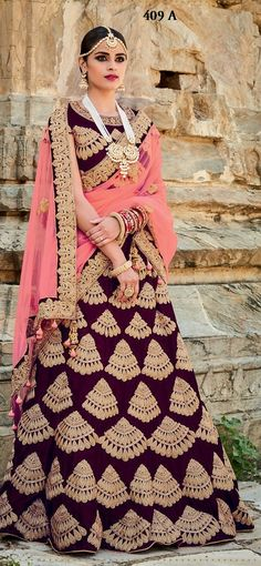 Price @15749.00 INR  Colour : Maroon & Pink  Top Material : Pure Two-Tone Velvet  Lehenga Material : Pure Two-Tone Velvet  Dupatta Material : Net  Work : Heavy Embroidery With Handwork