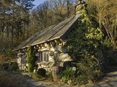 """The Ugly House, Betws-y-Coed, Wales. Legend has it that it was built as a """"Ty Un Nos"""" or a house built overnight in the 15th century by two outlaw brothers. The motive appears to be that ancient law stated that if a house could be built from sunrise to sunset with walls, a roof and chimney those who built it could claim the freehold. It is apparently built with no mortar!"""