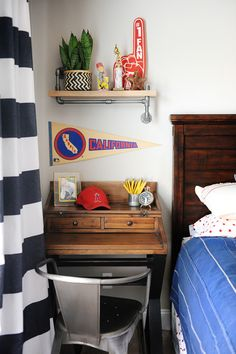 A fun metal desk chair and accessories from HomeGoods help make this bedroom more industrial feeling, a perfect bedroom space for a tween or teen boy. Sponsored pin.
