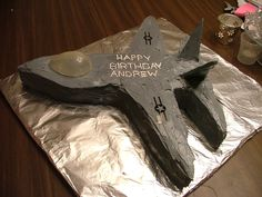 Fighter jet birthday cake.  Made from 1 9x13 cake, strategically cut and rearranged and 1 graham cracker cut and frosted for the tail.  Easy.